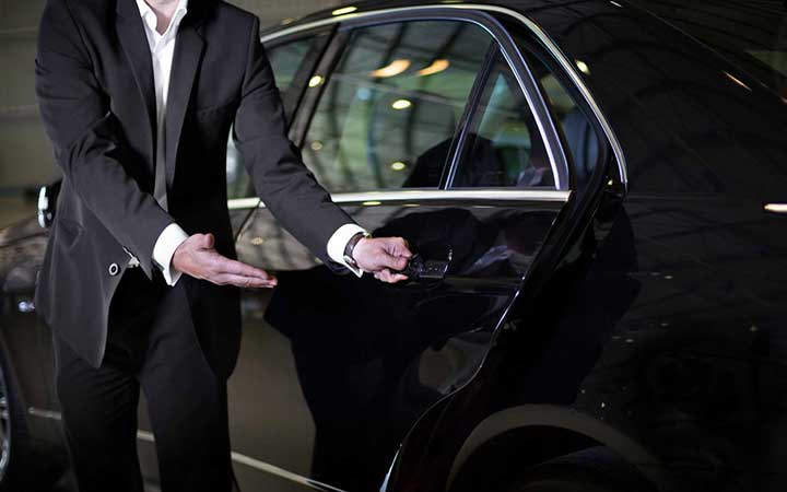 Image of chaeuffeur opening door for passenger - Luxian of London Chauffeur and Drive You Home Service